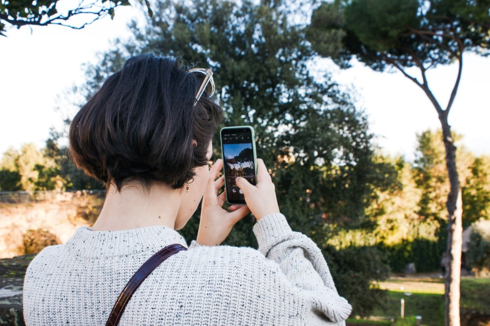 A person takes a photo on their smartphone.
