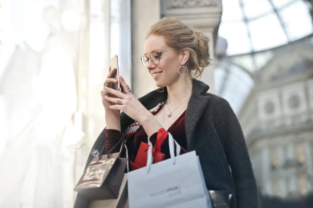Girl Shopping and Taking Pictures on her Mobile Phone