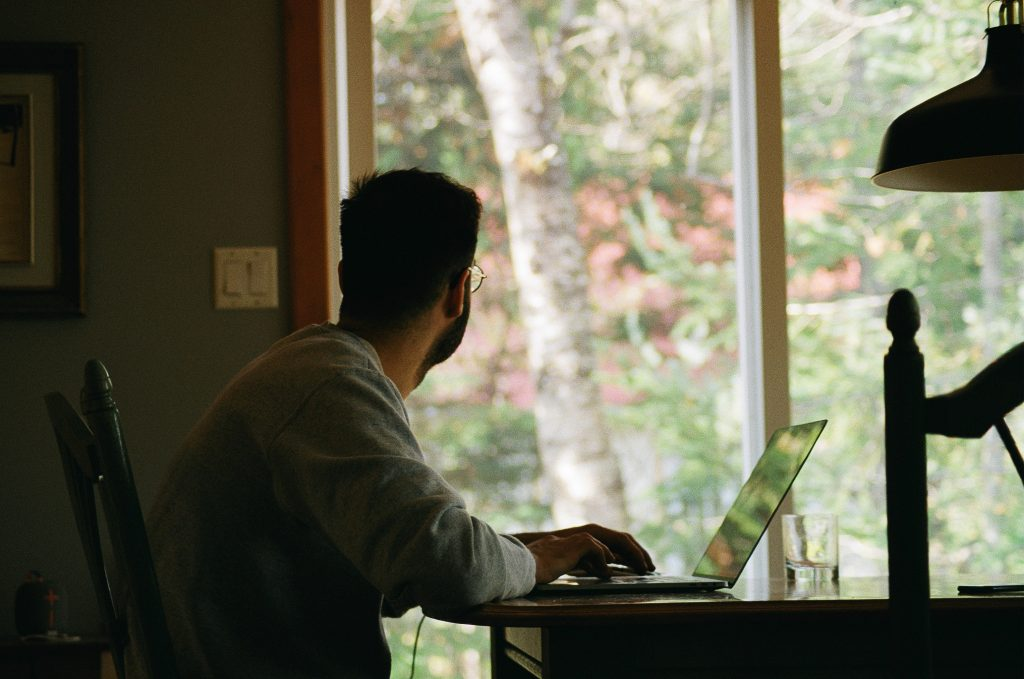 man working from home on his laptop